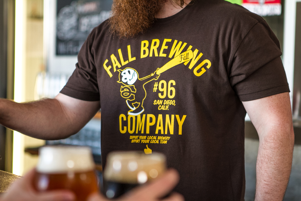 Brown Sports Ball Shirt Being worn by a beertender