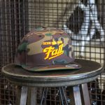 Camo and gold embroidered Fall Brewing Company script hat