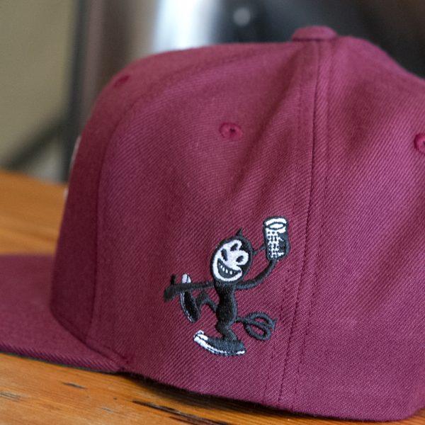 Close up shot of embroidered devil cat hat