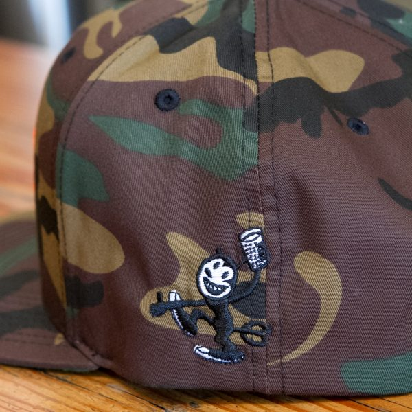 Close up of camo embroidered Fall Brewing Company hat