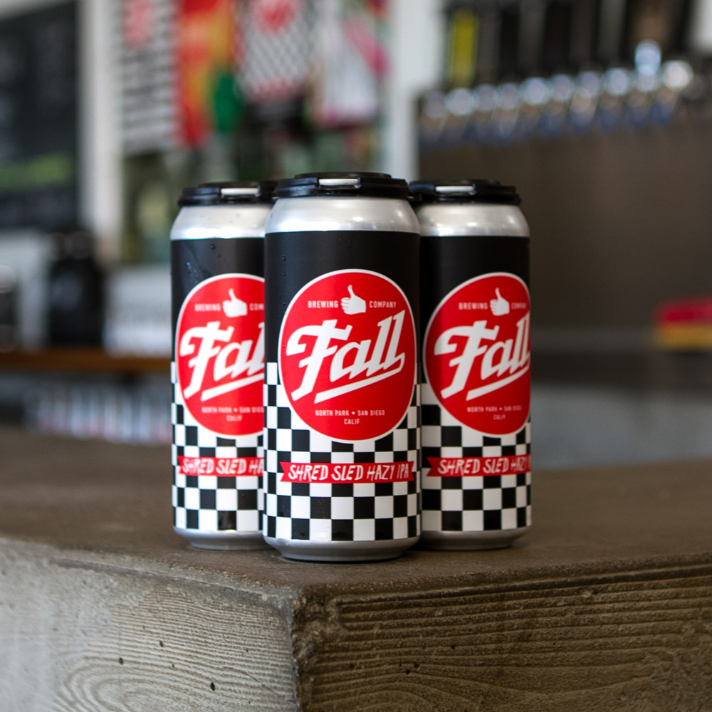 4-Pack of Fall Brewing Company Shred Sled Hazy IPA sitting on tasting room counter
